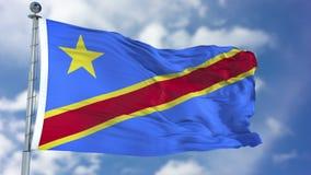 Флаг демократической республики Конго в голубом небе Стоковые Фото