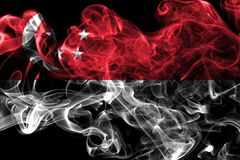 Флаг дыма Сингапура на черной предпосылке Стоковое Фото
