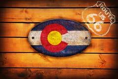 Флаг Колорадо и экран трассы 66 бесплатная иллюстрация