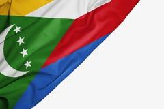 Флаг Коморских Островов ткани с copyspace для вашего текста на белой предпосылке иллюстрация вектора