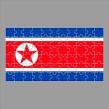 Флаг Корейской Северной Кореи от головоломок на серой предпосылке иллюстрация штока