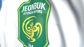 Флаг летая с Jeonbuk Hyundai едет на автомобиле логотип клуба футбола FC, конец-вверх Редакционная loopable 3D анимация сток-видео