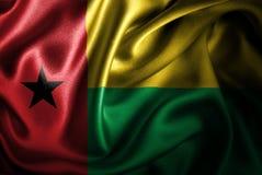 Флаг сатинировки Гвинеи-Бисау Silk Стоковое Изображение RF