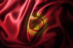 Флаг сатинировки Кыргызстана Silk Стоковая Фотография