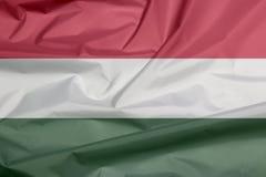 Флаг ткани Венгрии Залом венгерской предпосылки флага иллюстрация вектора