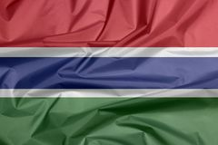 Флаг ткани Гамбии Залом гамбийской предпосылки флага иллюстрация штока