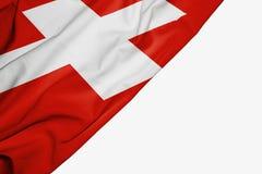 Флаг Швейцарии ткани с copyspace для вашего текста на белой предпосылке иллюстрация штока