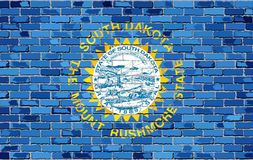 Флаг Южной Дакоты на кирпичной стене Стоковые Фотографии RF