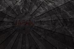Флаг Японии восходящего солнца высек в черном камне шифера Стоковая Фотография RF