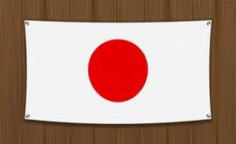 Флаг Японии на темной деревянной предпосылке стены бесплатная иллюстрация
