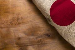 Флаг Японии сделал от грубой ткани Стоковые Фото
