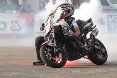 Фокусы Narcis Roca с мотоциклом Стоковое фото RF