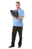 фокус доктора смотря рентгеновский снимок Стоковая Фотография