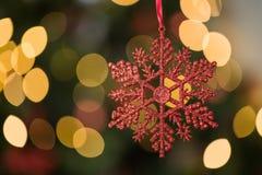 Фокус на красном украшении рождества звезды Стоковая Фотография