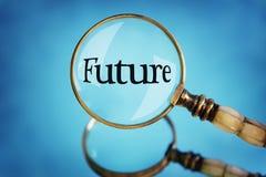 Фокус лупы на будущем слова стоковое фото rf