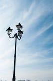 Фонарик на предпосылке голубого неба Стоковое Изображение RF