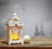 Фонарик рождества и снежные ели Стоковая Фотография