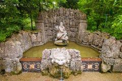 Фонтан с скульптурой Нептуна в парке фокуса воды Hellbrunn стоковое фото