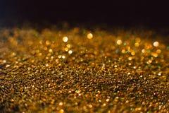Фон праздника абстрактных сияющих ярких блесков золотой Стоковое Изображение