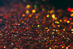 Фон праздника абстрактных сияющих ярких блесков оранжевый Стоковые Изображения