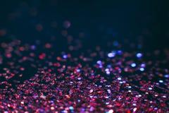 Фон праздника абстрактных сияющих ярких блесков фиолетовый Стоковые Изображения RF