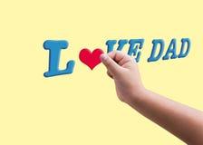 Форма владением ребенка или руки kid's красная услышанная заполняя к голубому тексту l Стоковые Изображения
