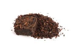 Форма квадрата чая Puer изолированная на белой предпосылке Отжатый чай pu-erh заквашенный китайцем Стоковые Изображения RF
