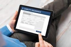 Форма обязательства по страхованию на планшете Стоковые Изображения RF