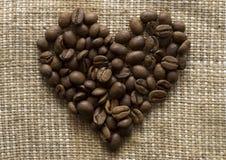 форма сердца кофе фасолей Стоковое фото RF