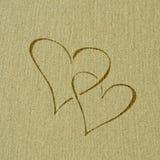 Форма сердца на поверхности песка Стоковые Изображения RF