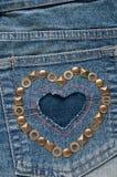 Форма сердца на ткани джинсовой ткани Стоковое Изображение RF