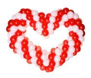 Форма сердца сделанная от красных и белых воздушных шаров Стоковое Фото
