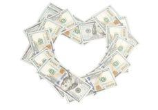 Форма сердца сделанная счетов долларов Стоковая Фотография