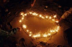формировать sparklers ночи сердца Стоковые Изображения RF