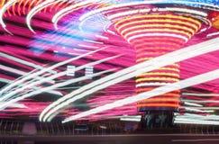 Фотография долгой выдержки Света Carousel и движения, Великобритания стоковая фотография rf