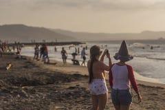 Фотография пляжа женщинами Стоковые Фотографии RF
