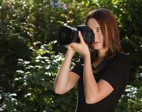 Фотограф женщин стоковая фотография rf