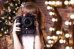 фотограф камера девушка звезда Интерьер рождества Новый Год Стоковая Фотография