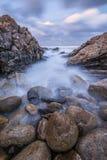Фотоснимок захода солнца туманных волн Стоковые Изображения