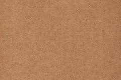 Фотоснимок рециркулирует текстуру Grunge бумаги Брайна Kraft грубого зерна Striped Стоковое Изображение RF