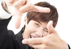фотоснимок человека обрамляя на белой предпосылке Стоковые Изображения RF