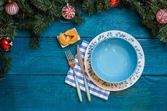 Фото ветвей ели, печений с прогнозом, плит Нового Года, ручек для суш Стоковая Фотография