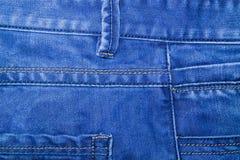 Фото голубых джинсов, часть джинсовой ткани одежды Стоковые Изображения