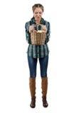 Фото женщины смотря корзину с яблоками Стоковое фото RF