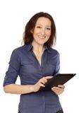 Фото молодой женщины на работе на ее ПК таблетки Стоковая Фотография