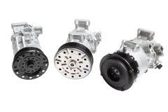 Фото на составе 3 частей для двигателя Генератор, компрессор кондиционера и стартер на задней части серого цвета Стоковые Фото