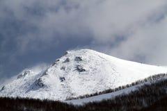фото пика горы рассвета принятое снежное светлого пурпуровое Стоковые Фото