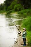 Фото рыболовства мальчика Стоковое Изображение
