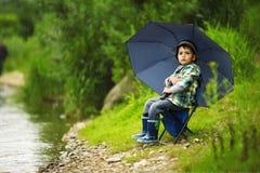 Фото рыболовства мальчика Стоковые Фото