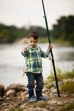 Фото рыболовства мальчика Стоковое Фото